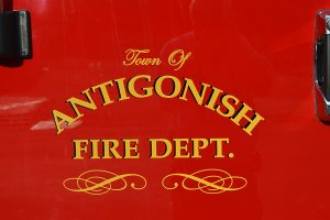 red door of truck with Antigonish Fire Dept on it
