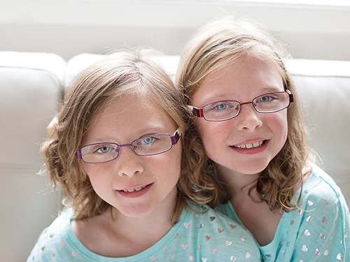 Two young girls in hospital gowns