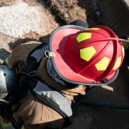 red helmet on firefighter
